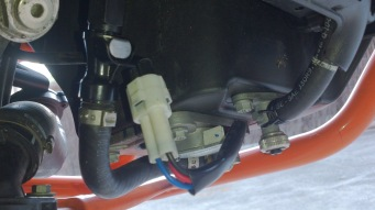 (from left) Main Fuel injector to fuel pump. White fuel pump electric connector and right fuel hose with screwable tap